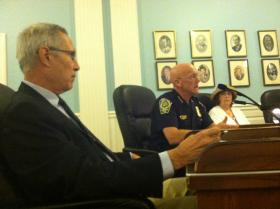 Alderman-at-Large Jim Donchess, left, listens as Nashua Police Chief John Seusing speaks with city officials about increases in crime.