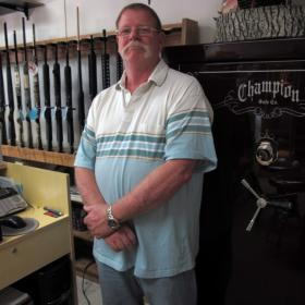 Although Bob Lee keeps a computer backup of his antique firearms records, he prefers using bound record books.