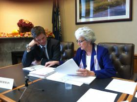 Senator Nancy Stiles working with a consultant on the final version of the Medicaid Expansion Commission report.
