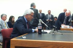Senate President Chuck Morse prepares to give testimony during a public hearing on Medicaid expansion.