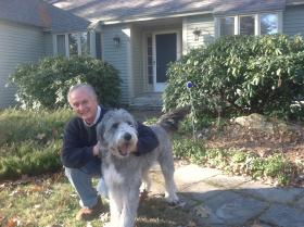 Richard Polonsky, with his dog Bella, at home in Bedford.