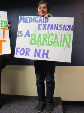 Toni Trotzer of Hampton, NH shows her support for medicaid expansion in New Hampshire.