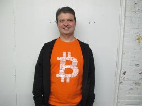 Pedro Aguiar sports a bitcoin-themed tee-shirt.