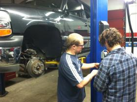 Students work in the automotive program at Lakes Region Community College in Laconia.