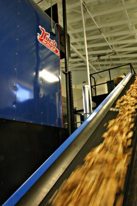 Wood chips are automatically fed into the new boiler being used by Grafton County. Photo by Chris Jensen