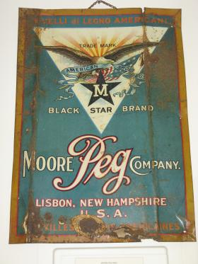 Old sign of Moore Peg Company in Lisbon which at one time was one of the world's leading manugacturers of shoe pegs