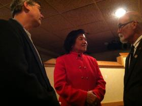 Karen Testerman, center, speaks with supporters Tuesday night at an event in Manchester.