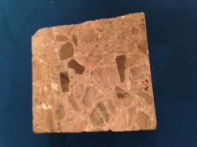 A sample of concrete degraded because of an alkali-silica reaction.