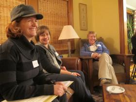 Christy Hegarty, Jill Pare, and Doreen Wachenschwanz gather at Janet Groat's home to discuss advocacy strategies.