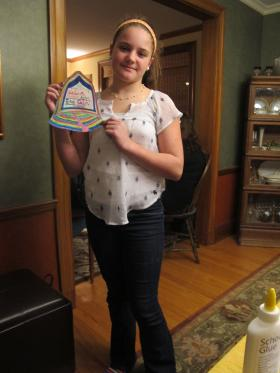 Sixth grader Catie Hegarty and other mothers and children decorated bell-shaped letters with messages to lawmakers asking for stronger gun control laws.
