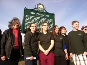 NHTI President Lynn Kilchenstein, left, poses with students at the unveiling of a historic marker last month.
