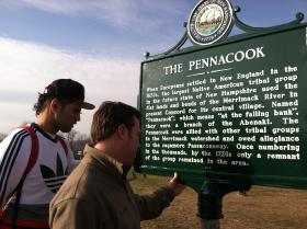 Students look at the new historical marker on the New Hampshire Technical Institute in Concord.