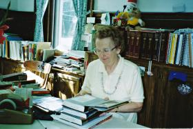 Muriel (Jobin) Brown in the town library where she worked for more than three decades. Photo courtesy of the family.