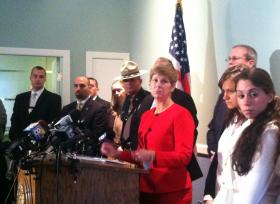 Associate Attorney General Jane Young at a press conference in Concord.