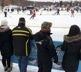 Spectators watch the action at the Black Ice Pond Hockey Championship.