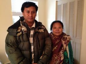 Tara Gurung (right) and her husband in their old apartment.