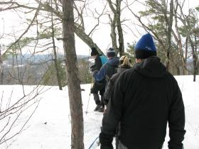 """The crew descends via the Boulder Loop trail. Each hiker has their limit for what they consider bad weather. Richardson won't hike in """"heavy, or even moderate rain"""", while Gayle Gosselin will only head out up if it's above -5 degrees Fahrenheit at her house."""