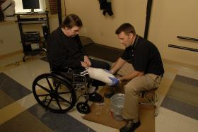 Jason Lalla fits a client for a new prosthesis