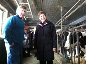 Allen Bartlett speaks with U.S. Senator Jeanne Shaheen during her visit to Bartlett Farm Dairy in Concord.