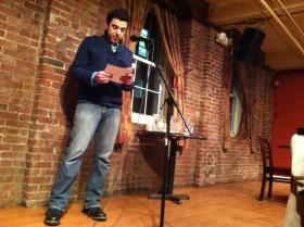 Tony Rivera reads his story at the Three Minute Fiction Slam at Milly's Tavern in Manchester. The event is organized by the New Hampshire Writers Project.