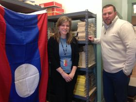 Principal Christopher Andriski poses with Megan Boyle, an 11th grade English teacher at Newmarket High School. They are standing in an ESL study room that doubles as a storage space.