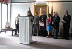 Diana Lacey, president of the State Employees' Association, speaking at a press conference in Concord on Monday.