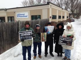 A core group of activists who gather on Pennacook street every Thursday, even if it snowed the night before.