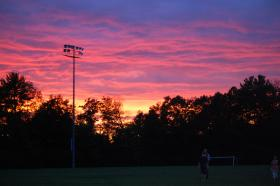 The sky over Robbie Mills Field at the end of a Laconia Muskrats game.