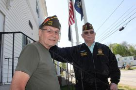 Former VFW Post 483 Commander Barry Palmer, left, and post member Lew Chipola, right, outside the Hudson American Legion, where they have been meeting regularly since their Nashua post closed in 2013.