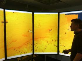 "At UNH's data visualization lab, researchers can display their data on four connected computer monitors, which are arrayed in a semi-circle for a ""wrap-around"" effect."