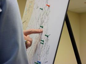 Richard McCaffrey, a lawyer for the Insurance Department, uses thumb tacks to mark providers in Strafford County.