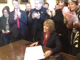 Governor Maggie Hassan signs New Hampshire's Medicaid expansion plan into law on March 27, 2014.