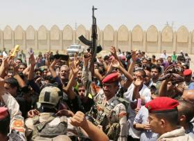 Iraqi army soldiers and volunteers in Baghdad on Saturday