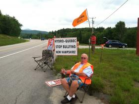 Tom Mullen of the Owl's Nest Resort, a staunch Northern Pass Opponent, was one of the earliest arriving protesters