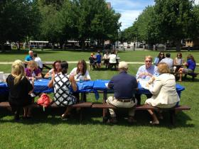 Residents and business people bring their lunches to eat at park tables at Veterans Park.