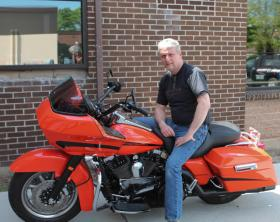 Boomer entrepreneur Steve Young poses on his motorcycle.