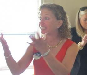 Democratic National Committee Chair Debbie Wasserman-Schultz addresses female volunteers at the home of N.H. House Speaker Terie Norelli.