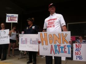 Market Basket worker Justin Desjardins holds a sign outside the downtown Concord Market Basket last week. Like most employees, he's rallying outside, but also continues to work.