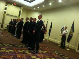 Police Chief David Mara, right, looks on as 14 new members of the Manchester Police Department are sworn in Monday.