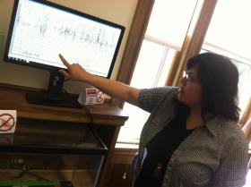Merrimack Public Library Director Yvette Couser explains how the seismograph works. It's the state's only publicly-available seismograph.