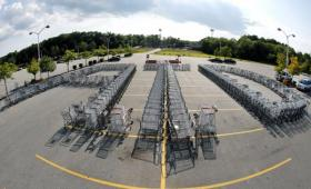 Shopping carts are arranged forming the letters ATD in the parking lot of a Market Basket Supermarket in North Andover, Mass., Monday, Aug. 11, 2014, in support of former CEO Arthur T. Demoulas.