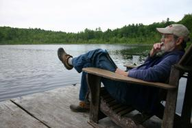 Tom Fredenburg relaxes on his dock on Snow Pond, Concord.