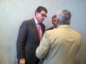 Texas Gov. Rick Perry mingles at an Americans for Prosperity event in Manchester Friday.