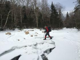 While most aspects of hiking in winter are more complicated, river crossings are not.