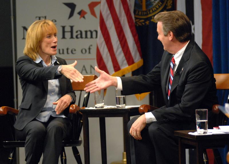 Democrat for governor Maggie Hassan and Republican challenger Ovide Lamontagne shake hands while debating at St. Anselm College in Manchester on Wednesday, Sept. 19, 2012.