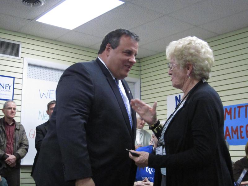 Christie chats with a Romney supporter.