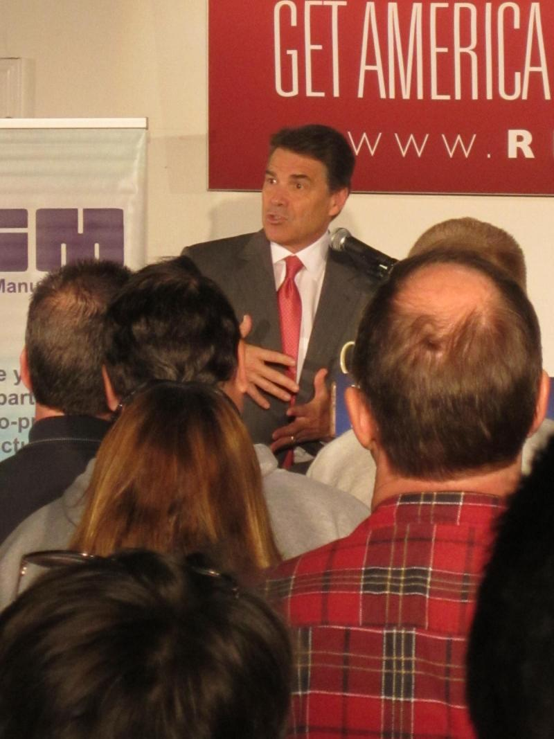 Perry speaks to workers at GSM plant in Manchester