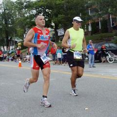 (left) John Rymes running in Lake Placid Ironman Triathlon