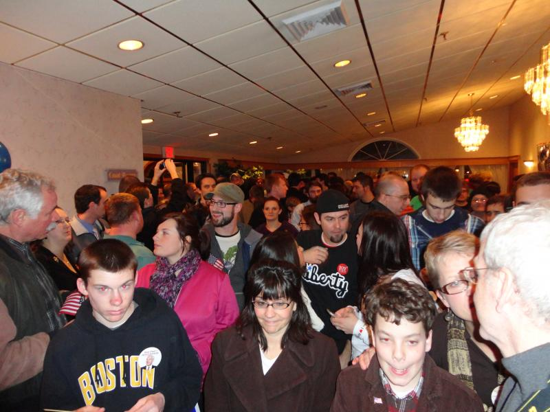 A crowd waits at the door to be let in to Ron Paul election night headquarters.