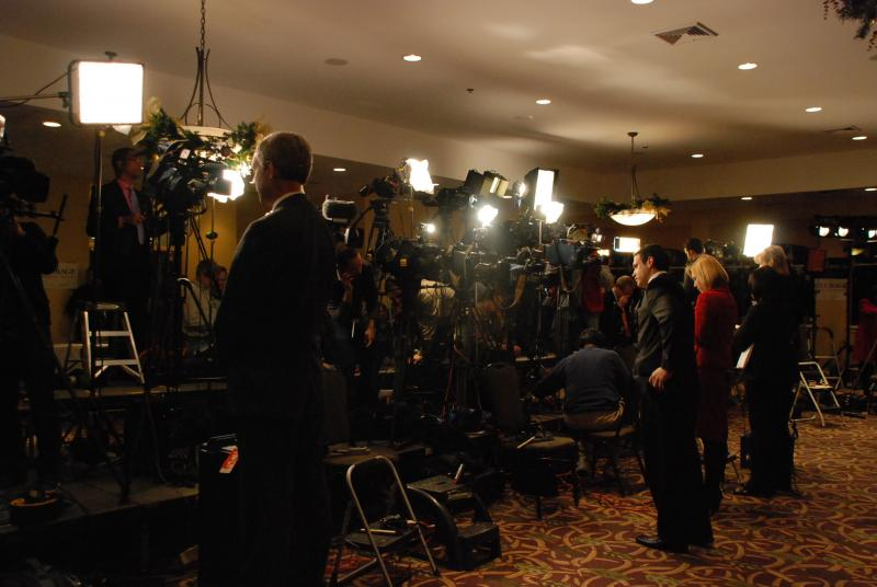 Live crews stand by for their 6:00 reports at the Santorum campaign party in Manchester, NH. The audio from the podium has been plagued by a buzz, much to the chargrin of the broadcast media.